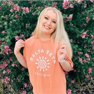 Delta Zeta member wearing Life is Good t-shirt with image of the sun
