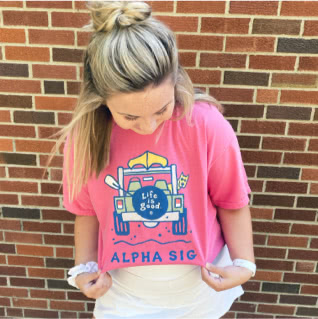 Alpha Sigma member wearing Life is Good t-shirt with image of a jeep